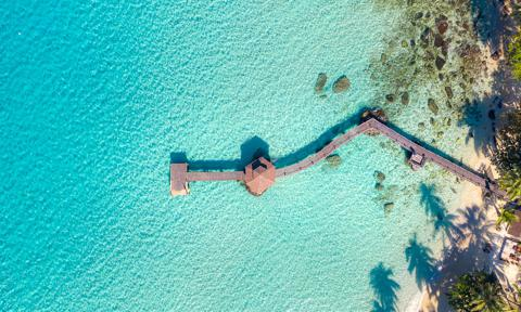 Aerial view of wooden bar in sea and hut with nice blue sky in Koh Kood at Trat, Thailand. Asia Summer, Travel, Vacation and Holiday concept.