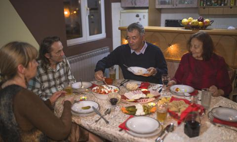 Family eating and spending holidays together at home