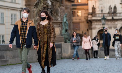 A young couple wearing face masks as a preventive measure